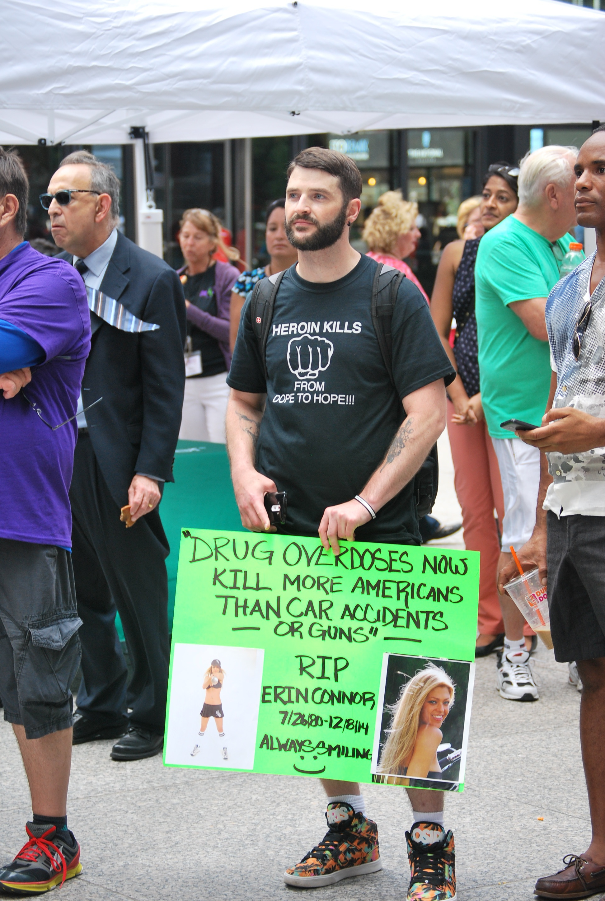 overdose_awareness_day_guy_holding_sign.jpg